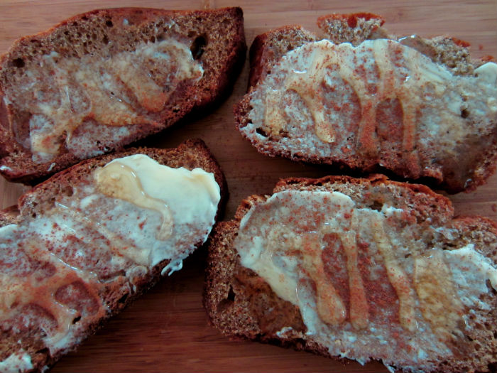 banana bread served with honey and cinnamon