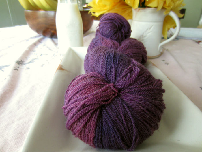 amethyst oviraptor lace yarn with background