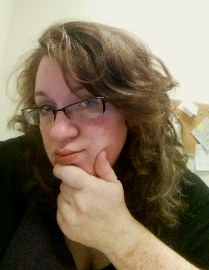case in point: second day hair after straightening my bangs. The bulk of my hair is a little flatter than normal, but my bangs, which started the day straight curled up to match.
